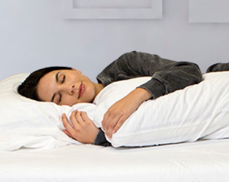 Young women sleeping on white bed - Nectar Sleep - the most comfortable mattress