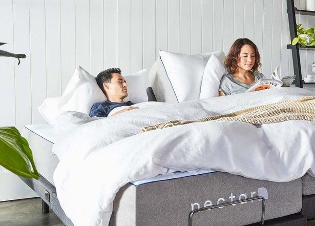 couple sleeping on nectar adjustable bed frame